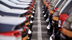 Why is the assistance of auto dealers important while buying a car?